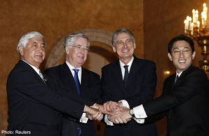 From left to right: Japanese Defence Minister Gen Nakatani, British Defence Secretary Michael Fallon, British Foreign Secretary Philip Hammond and Japanese Foreign Minister Fumio Kishida shake hands during a meeting at Lancaster House ahead of a meeting in London, January 21, 2015.