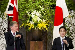 Foreign Minister Fumio Kishida and British Foreign Secretary Philip Hammond attend a news conference at Iikura House in Tokyo on Saturday. | REUTERS