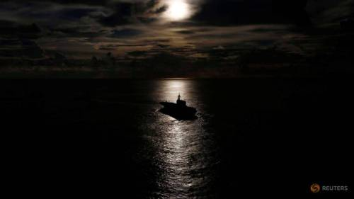 japanese-helicopter-carrier-kaga-is-silhouetted-against-the-reflection-of-the-sun-on-the-ocean-during-a-joint-naval-drill-with-british-frigate-hms-argyle-and-japanese-destroyer-inazuma-i